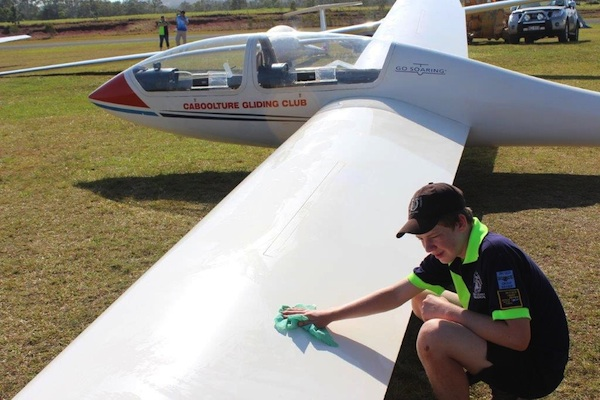 A cadet cleans a glider before the days flying commences