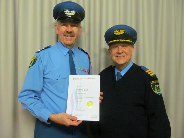 Wing Captain Martin Ball receiving his Certificate in Active Volunteering