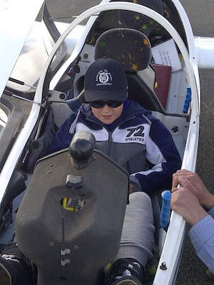 A young cadet enjoying air experience flight