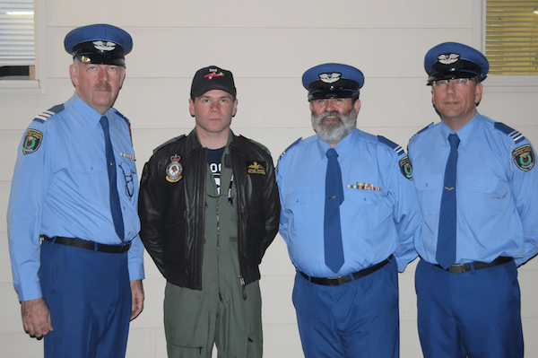 Pilot Officer Lachlan Johnston with Group Lieutenant Martin Ball (Left), First Officer Mark Borchard and Squadron Lieutenant Andrew Jacks